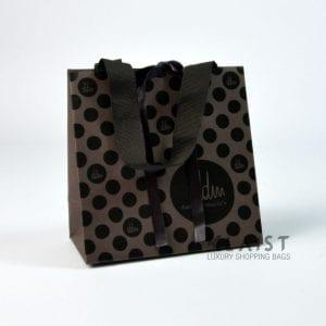 shopper personalizzate in carta con maniglie in fettuccia e nastro chiusura lusso